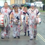 Cold & wet but colourful & cheerful drummers returning from the rain-soaked Carnival