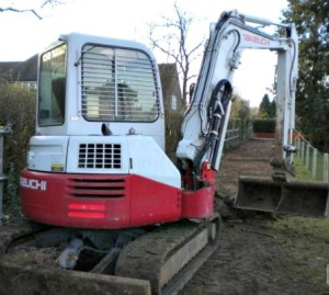 Brazen thieves drive off with digger